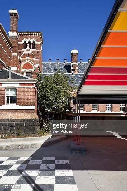 With primary school building in shot SKIPPS Shade Structure St Kilda Park Primary School Melbourne Australia Architect Grant Amon Architects Nervegna...