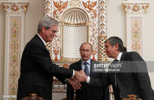 With Russia's President Vladimir Putin watching Russian oil giant Rosneft CEO Igor Sechin and President of ExxonMobil Exploration Company Stephen...