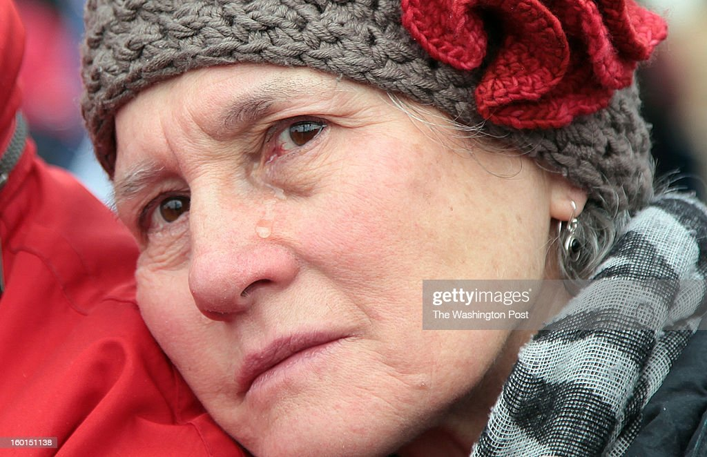U.S. With tears in her eyes, Gertrud Mergner, who is German and lives with her husband in Takoma Park, MD, listens to the speakers of the March on Washington for Gun Control at the Washington Monument where protesters gathered after marching from the U.S. Capitol. 'I am here to support gun control laws,' says Mergner.