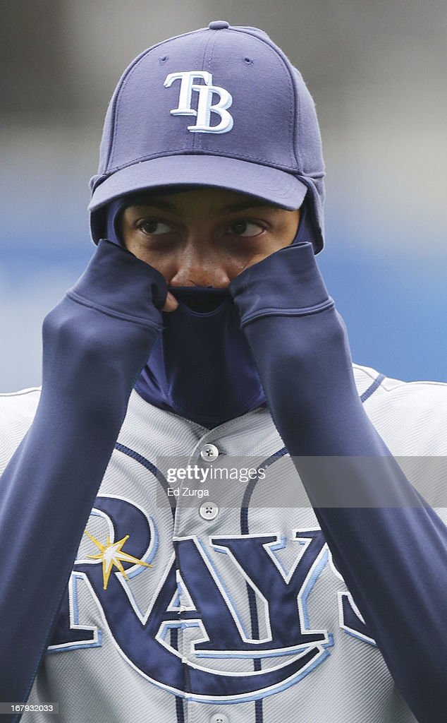 With temperatures hovering around 40 degrees, Desmond Jennings #8 of the Tampa Bay Rays adjust his head liner as he tries to stay warm prior to a game against the Kansas City Royals at Kauffman Stadium on May 2, 2013 in Kansas City, Missouri.