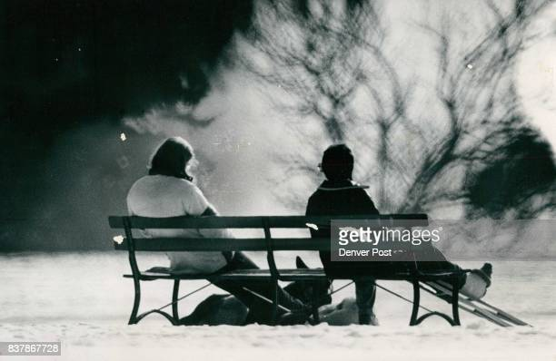 With temperatures in the low 20s in Denver Sunday some people found the day good enough for a visit to Cheesman Park These two women relax to take in...