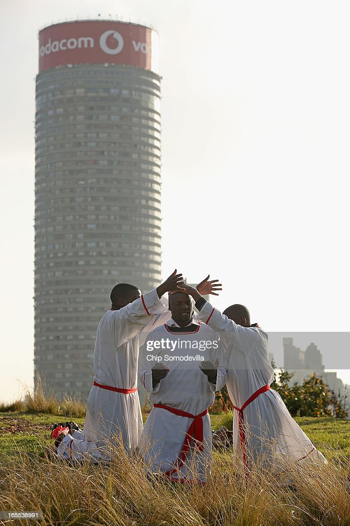 With the 173-meter tall Ponte Tower looming in the background, members of the Twelve Apostles Church of Christ kneel in prayer on a hill in the Yeoville neighborhood April 4, 2013 in Johannesburg, South Africa. Members of the church, many of them immigrants from Zimbabwe, gather to pray in the open on the hill overlooking downtown Johannesburg because they say the Bible tells the faithful to go to the mountaintop to pray. According to government officials, Noble Peace Prize laureate and former South African President Nelson Mandela, 94, contiunes to recover from pneumonia after spending more than a week in the hospital, his third time since December.