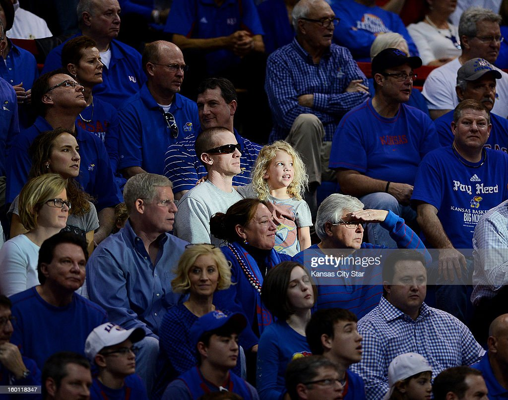 With the afternoon sun streaming through the south windows of Allen Fieldhouse, some Kansas fans were in the spotlight during the second half against Oklahoma in Lawrence, Kansas, on Saturday, January 26, 2013. The host Jayhawks won, 67-54.
