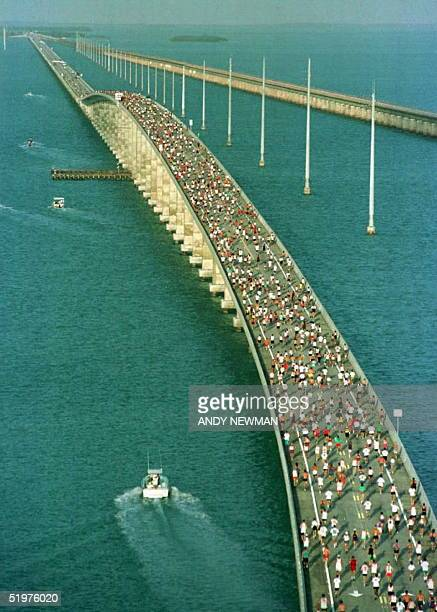 With the Atlantic Ocean at left and the Gulf of Mexico at right the main pack of 1500 runners competing in the 15th Annual Seven Mile Bridge Run in...