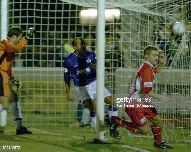 With the ball in the net Dagenham and Redbridge's Mark Janney turns to celebrate the opening goal against Exeter City's during the AXA FA Cup 2nd...