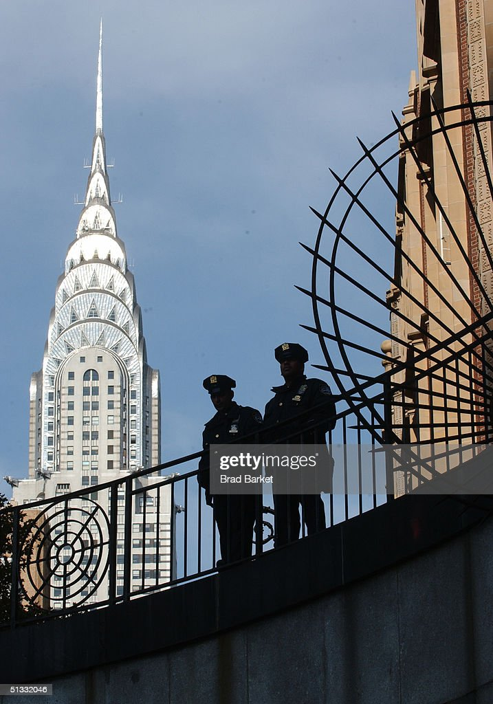 With the Chrysler Building shown in the background, New York Police Officers stand guard around the United Nations building as the UN General Assembly meets September 21, 2004 in New York. U.S. President George W. Bush addressed the conference of world leaders and defended his decision to go to war in Iraq.