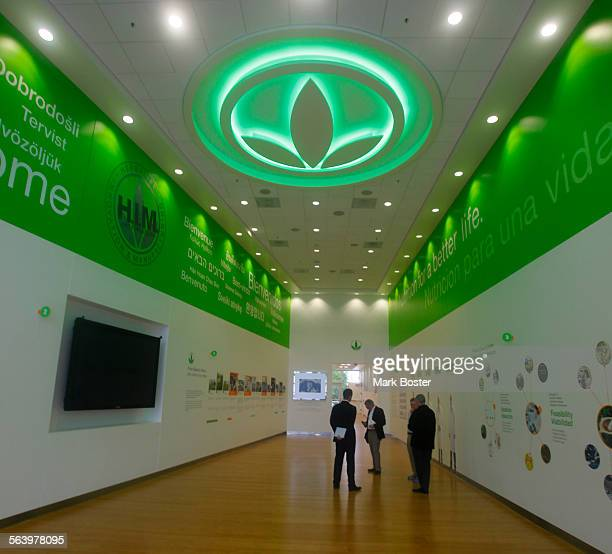 With the company logo glowing on the ceiling the lobby of the Herbalife manufacturing facility in Lake Forest California is an interactive gallery...