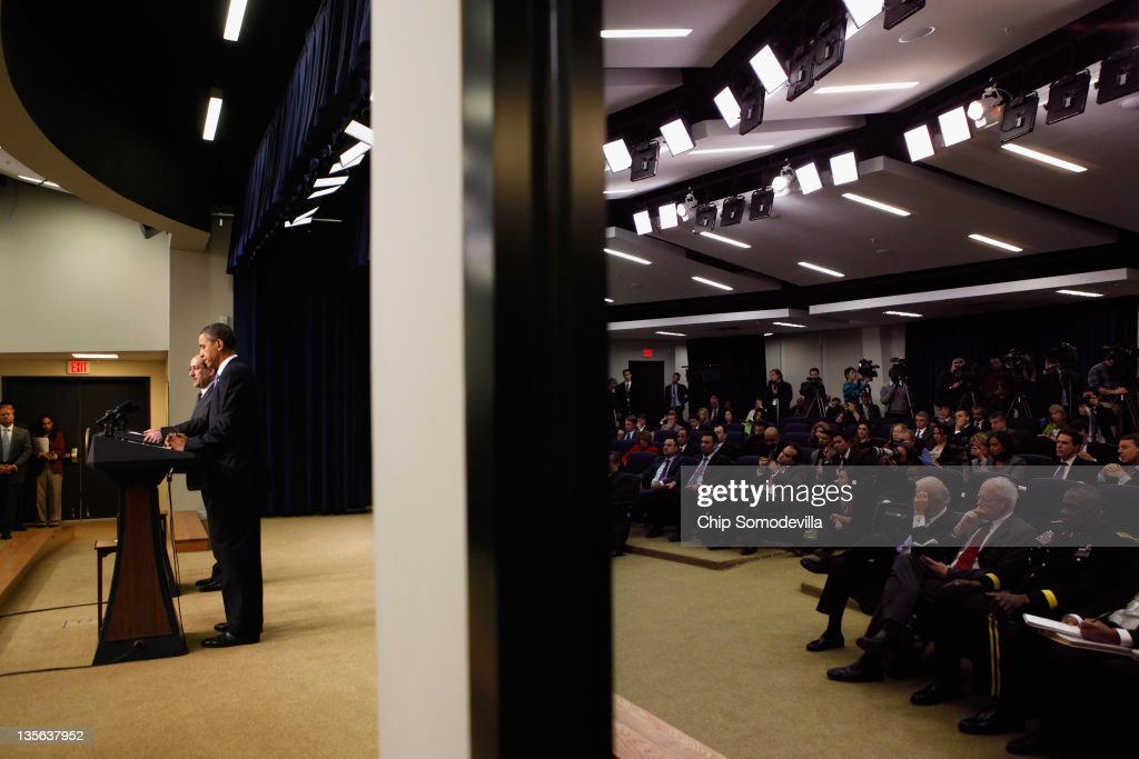 With the diplomats and journalists reflected in a window, Iraqi Prime Minister <a gi-track='captionPersonalityLinkClicked' href=/galleries/search?phrase=Nouri+Al-Maliki&family=editorial&specificpeople=539622 ng-click='$event.stopPropagation()'>Nouri Al-Maliki</a> and U.S. President <a gi-track='captionPersonalityLinkClicked' href=/galleries/search?phrase=Barack+Obama&family=editorial&specificpeople=203260 ng-click='$event.stopPropagation()'>Barack Obama</a> hold a news conference in the Eisenhower Executive Office Building next to the White House December 12, 2011 in Washington, DC. Al-Maliki is in Washington for talks ahead of the December 31 full withdrawal of U.S. troops from Iraq and the end of a deeply divisive nine-year war.