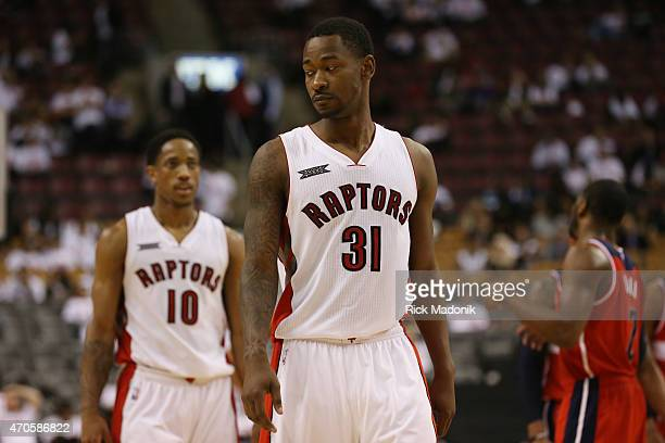 TORONTO APRIL 21 With the final seconds ticking off Terrence Ross and DeMar DeRozan walk up court Toronto Raptors vs Washingrton Wizards during 2nd...