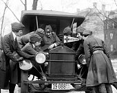 With the flu on the increase ambulance drivers are in demand for the American Red Cross so here a class is being instructed in the mysteries of an...