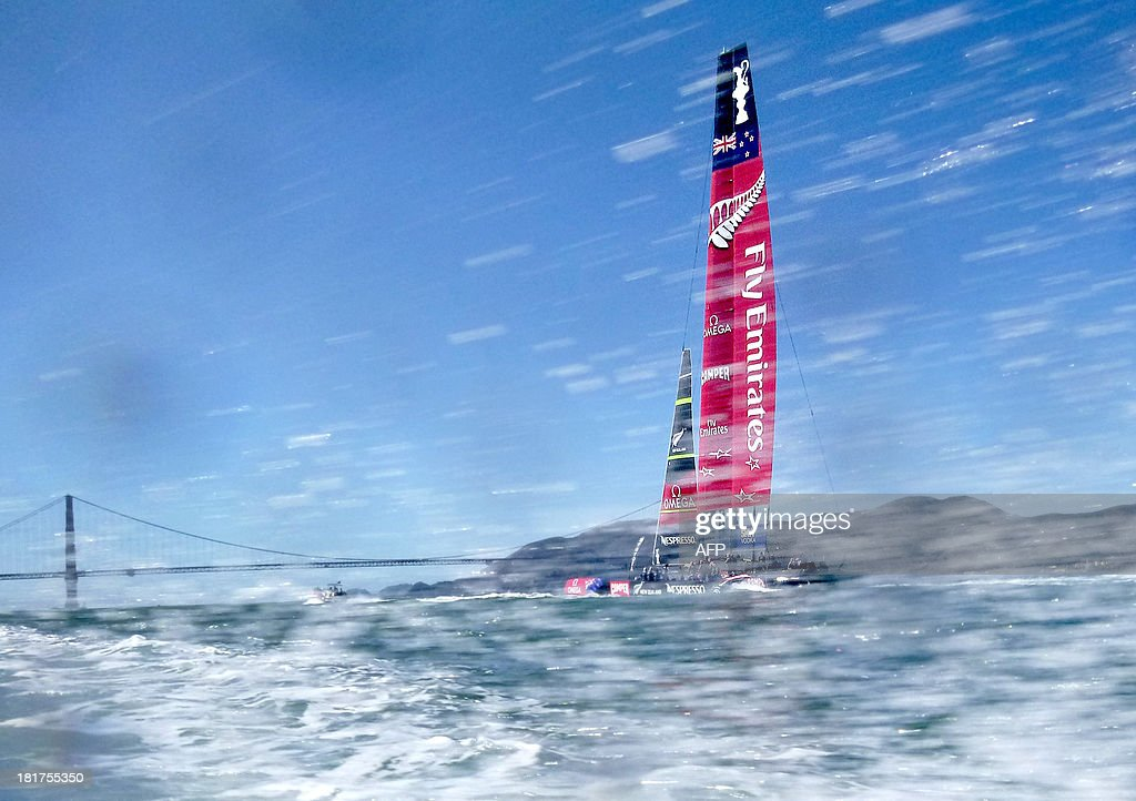 With the Golden Gate Bridge in the background, Emirates Team New Zealand heads to the start of America's Cup race 18 on September 24, 2013, in San Francisco. Following seven consecutive wins, Oracle Team USA is now tied with New Zealand heading into Wednesday's final race. AFP PHOTO/NOAH BERGER