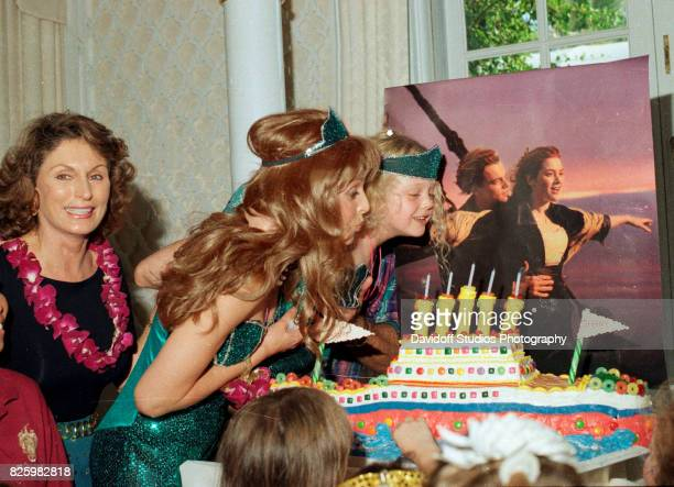 With the help of her mother actress Marla Maples Tiffany Trump blows out the candles on her 'Titanic'themed cake during her fifth birthday party at...