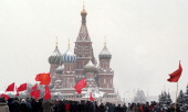 With the landmark StBasil's Cathedral in the background Communist party members and supporters walk in the Red Square in Moscow on December 21 to...