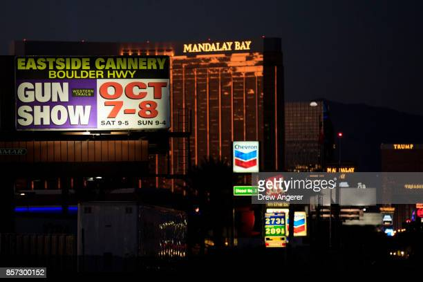With the Mandalay Bay Resort and Casino in the background a billboard advertising an upcoming gun show is seen along the Las Vegas Strip October 3...