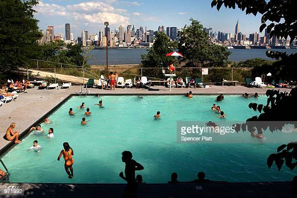 With the Manhattan skyline in the background swimmers escape the heat July 10 2002 in West New York New Jersey New York finally got a break from a...