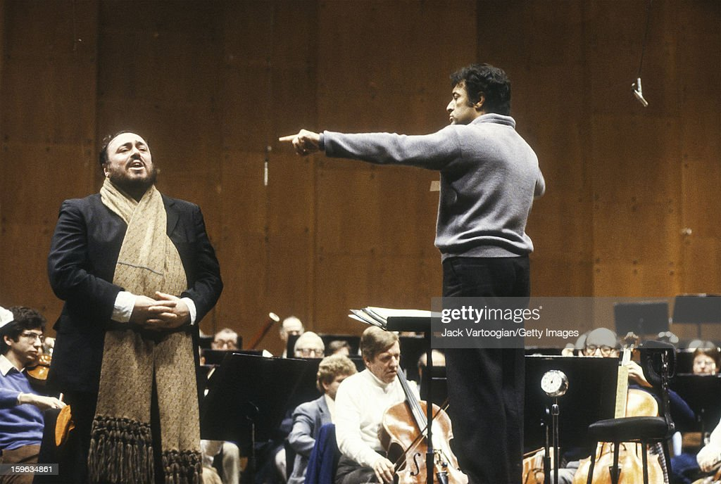 With the New York Philharmonic Orchestra, Italian tenor <a gi-track='captionPersonalityLinkClicked' href=/galleries/search?phrase=Luciano+Pavarotti&family=editorial&specificpeople=204196 ng-click='$event.stopPropagation()'>Luciano Pavarotti</a> (1935 - 2007) (left, fore) and Indian conductor <a gi-track='captionPersonalityLinkClicked' href=/galleries/search?phrase=Zubin+Mehta&family=editorial&specificpeople=548623 ng-click='$event.stopPropagation()'>Zubin Mehta</a> rehearse for the Public Television fundraising program 'Gala of Stars' at Lincoln Center's Avery Fisher Hall, New York, New York, January 12, 1980.