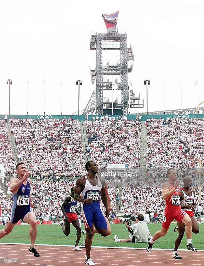 the olympic torch in the background great br pictures the olympic torch in the background great britain s linford christie c races