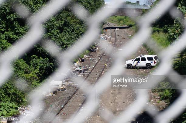 SUV with the Philadelphia Police Department is parked next to the train track at the heroin camp located in the Kensington Section of Philadelphia PA...