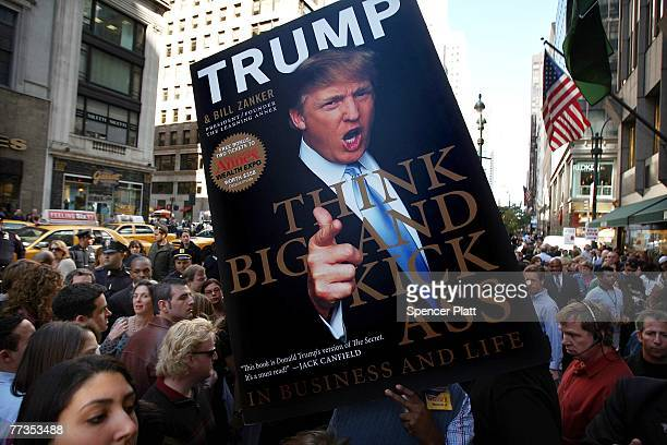 With the promise of the distribution of free money people converge on a Donald Trump book signing at an area bookstore October 16 2007 in New York...
