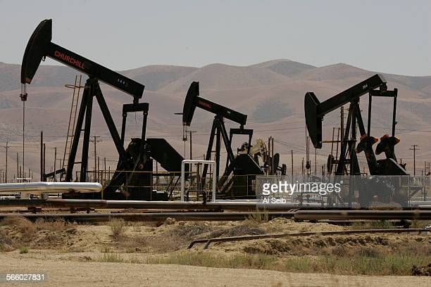 With the Temblor Mountain Range that contains the San Andreas Fault as a backdrop working oil pumps can be seen from California State Highway 33 that...