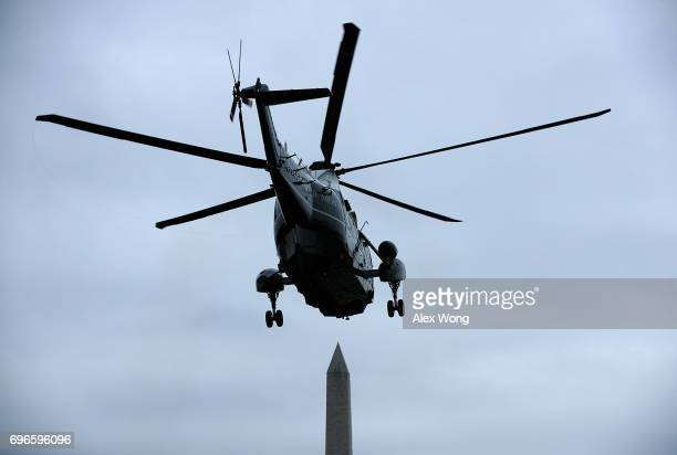 With the Washington Monument is seen in the background the Marine One takes off from the South Lawn of the White House with US President Donald Trump...