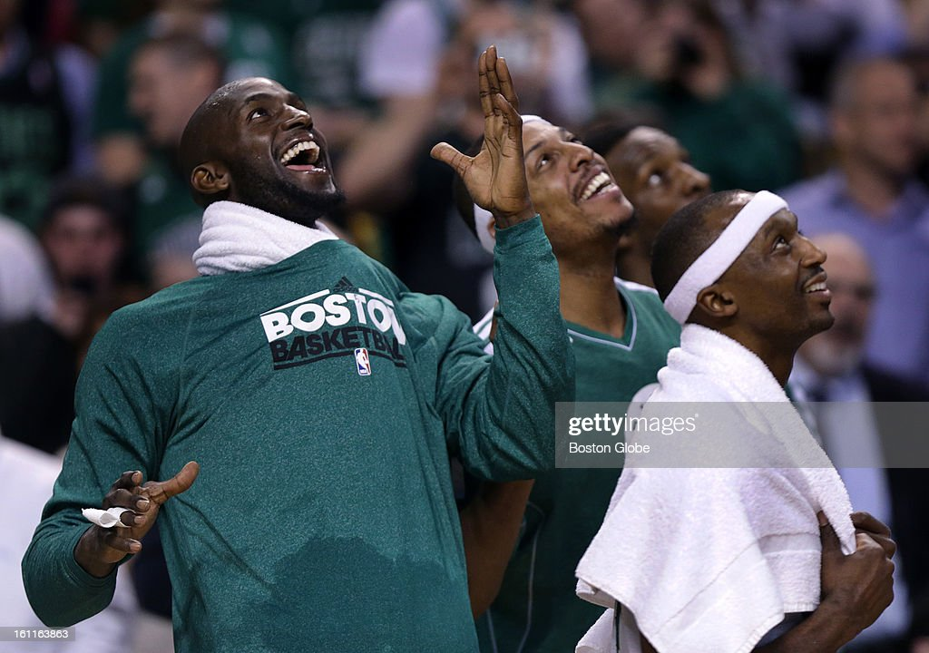 With the win over the Los Angeles Lakers safely in hand Boston Celtics power forward Kevin Garnett (#5) leads the way as he mimics the Gino dance moves on the Jumbotron scoreboard late in the fourth quarter as the Boston Celtics play the Los Angeles Lakers at TD Garden.
