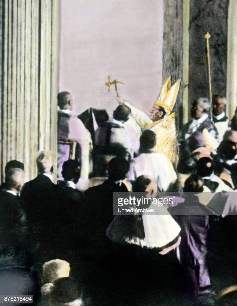 With three hammer strokes Pope Pius XI opens the Holy Gate for Jubilee year in 1925 Rome Italy 1920s