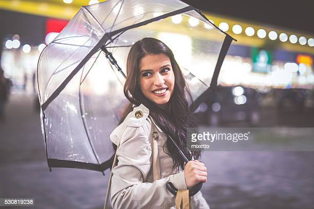 With umbrella in hand