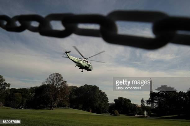 With US President Donald Trump on board Marine One lifts off from the South Lawn of the White House October 16 2017 in Washington DC Trump is...