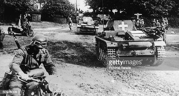 Without a formal declaration of war German tanks escorted by troops on motorcycles drive into Poland during the invasion Poland September 1 1939