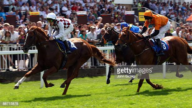 Without a Prayer ridden by Richard Kingscote wins the Totepool Midsummer Stakes at Royal Windsor Racecourse on June 27 2009 in Windsor England