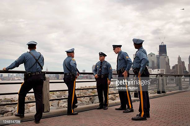 Witn One World Trade seen in the background New Jersey police officers wait for the memorial dedication to Empty Sky Memorial to start at Liberty...