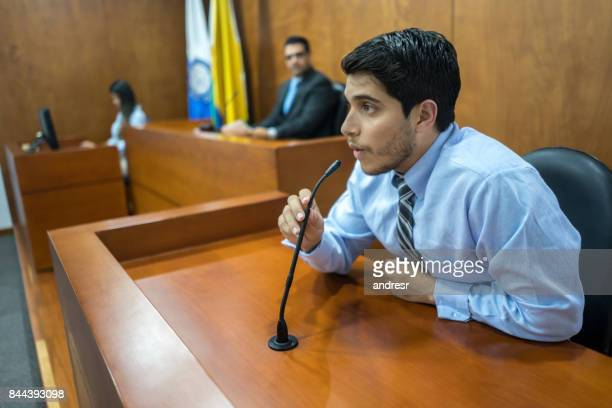 Witness addressing the courtroom in a trial