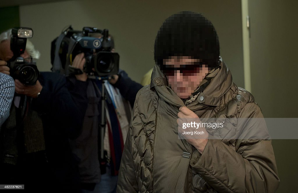 Witness Annerose Z., mother of co-defendant Beate Zschaepe, walks to today's NSU neo-Nazi murders trial on November 27, 2013 in Munich, Germany. Beate Zschaepe is accused of assisting neo-Nazis Uwe Mundlos and Uwe Boehnhardt in their eight-year murder spree that targeted nine immigrants and one policewoman.