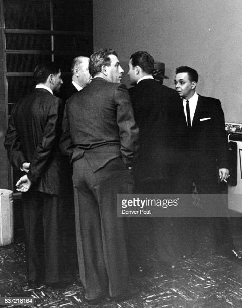 Witnesses before Jefferson County Grand Jury discuss situation with lawyer at Golden Left to right are Americus Quintana Joe Salardino Chauncey...