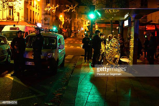 witnesses speak with journalists outside the Bataclan concert hall after an attack on November 13 2015 in Paris France According to reports over 120...