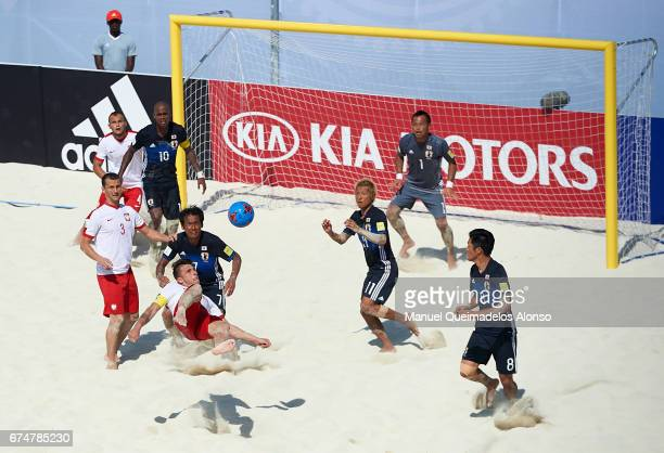 Witold Ziober of Poland attempts a scissor kick shot on goal during the FIFA Beach Soccer World Cup Bahamas 2017 group D match between Japan and...