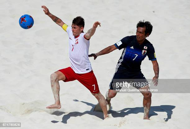 Witold Ziober of Poland competes for the ball with Teruki Tabata of Japan during the FIFA Beach Soccer World Cup Bahamas 2017 group D match between...