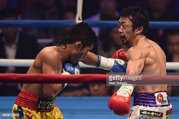 Wittawas Basapean punches Akira Yaegashi during the IBF World Light Flyweight Title bout between Akira Yaegashi of Japan and Wittawas Basapean of...