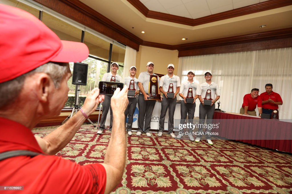 Wittenberg University receives the national champion trophy following the Division III Men's Golf Championship held at the Mission Inn Resort and Club on May 19, 2017 in Howey In The Hills, Florida.