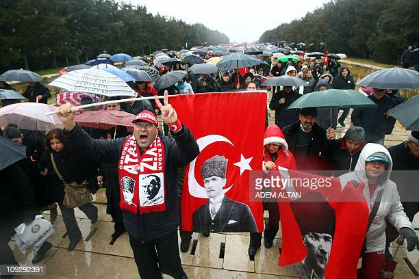 Wives and relatives of retired and active military officers charged in the socalled Sledgehammer trial hold flags featuring Mustafa Kemal Ataturk...