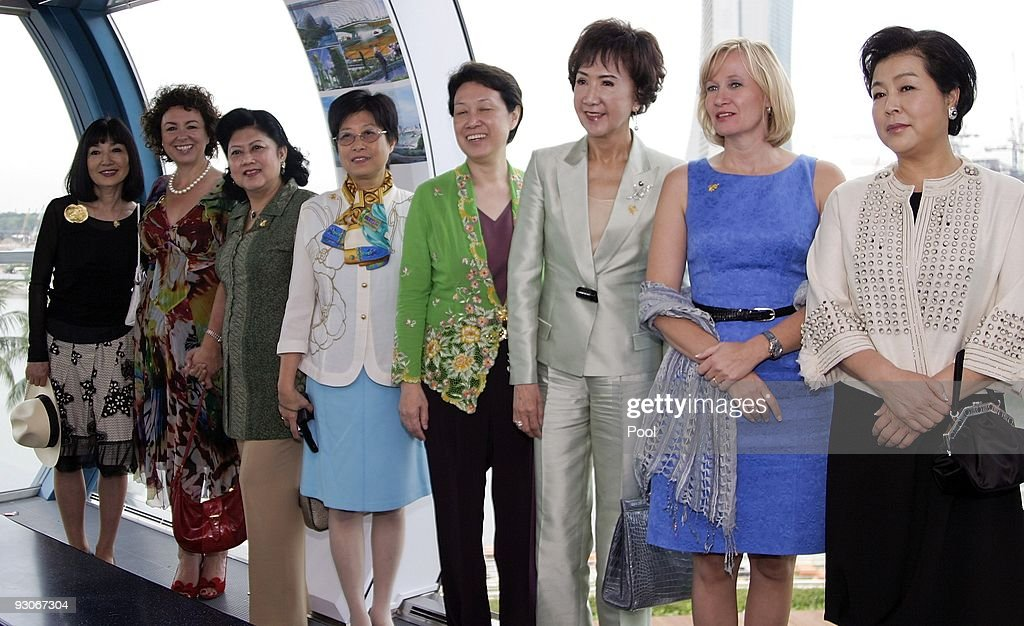 Wives of the Asia-Pacific Economic Cooperation (APEC) leaders, (L-R) <a gi-track='captionPersonalityLinkClicked' href=/galleries/search?phrase=Miyuki+Hatoyama&family=editorial&specificpeople=6126958 ng-click='$event.stopPropagation()'>Miyuki Hatoyama</a> of Japan, <a gi-track='captionPersonalityLinkClicked' href=/galleries/search?phrase=Therese+Rein&family=editorial&specificpeople=4264669 ng-click='$event.stopPropagation()'>Therese Rein</a> of Australia, Kristiani Yudhoyono of Indonesia, Selina Tsang of Hong Kong, Ho Ching of Singapore, Lien Fang Yu of Taiwan, <a gi-track='captionPersonalityLinkClicked' href=/galleries/search?phrase=Laureen+Harper&family=editorial&specificpeople=739519 ng-click='$event.stopPropagation()'>Laureen Harper</a> of Canada and Kim Yoon-Ok of South Korea pose before a tour on the Singapore Flyer observation wheel following the APEC Summit on November 15, 2009 in Singapore. The 2 day APEC CEO Summit, part of APEC Leaders Week, had brought together over 800 of the world's top business leaders and 15 world leaders in Singapore to address key global trade and economic issues.