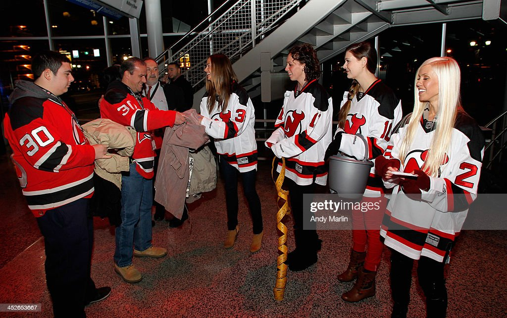 Wives of the New Jersey Devils collect coats during the Annual Coat Drive Night prior to the game between the Buffalo Sabres and the New Jersey...