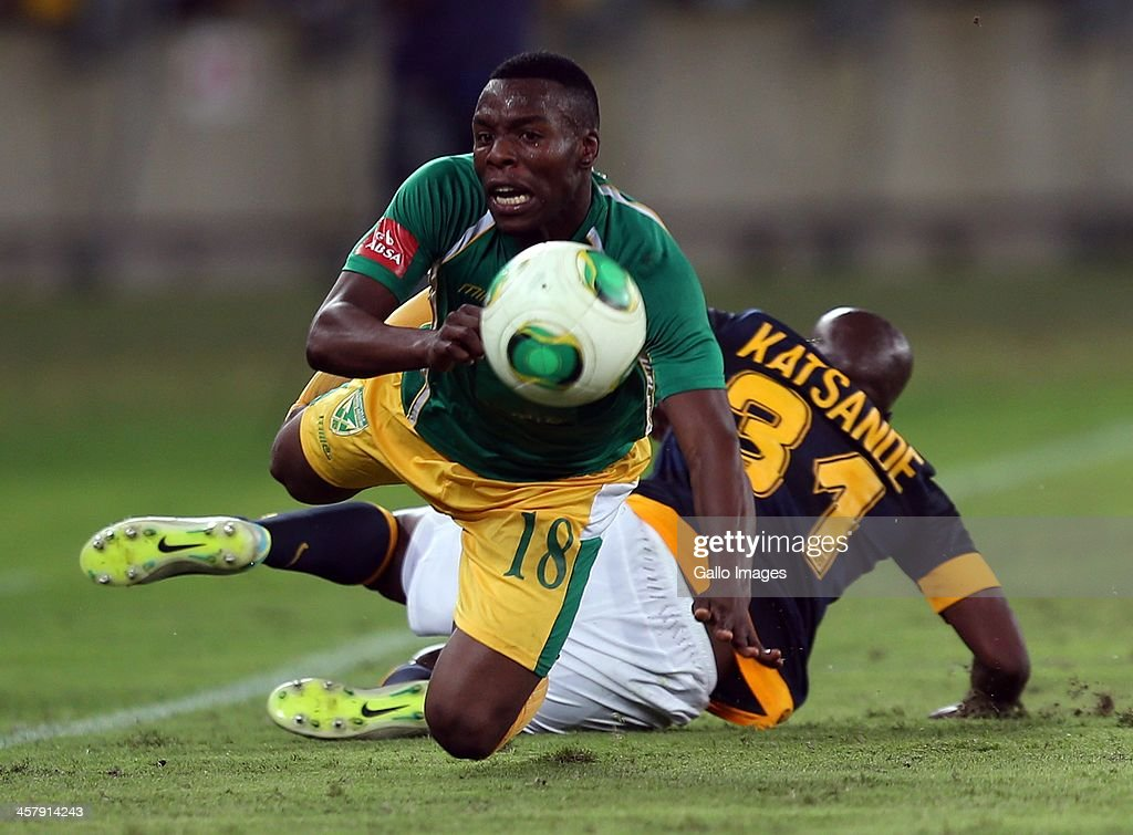 Wiyanda Zwane of Lamontville Golden Arrows is tackled by Willard Katsande (R) of Kaizer Chiefs during the Absa Premiership match between Golden Arrows and Kaizer Chiefs at Moses Mabhida Stadium on December 19, 2013 in Durban, South Africa.