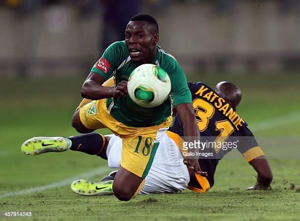 Wiyanda Zwane of Lamontville Golden Arrows is tackled by Willard Katsande of Kaizer Chiefs during the Absa Premiership match between Golden Arrows...