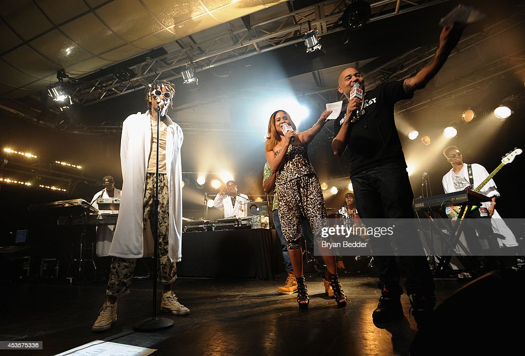 Wiz Khalifa, and iHeartRadio's Angela Yee and DJ Envy of The Breakfast Club speak onstage at the Wiz Khalifa performance at the iHeartRadio Live P.C. Richard & Son Theater on August 13, 2014 in New York City.