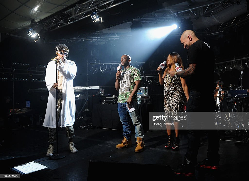 Wiz Khalifa, and iHeartRadio's Charlamagne Tha God, Angela Yee, and DJ Envy of The Breakfast Club speak onstage at the Wiz Khalifa performance at the iHeartRadio Live P.C. Richard & Son Theater on August 13, 2014 in New York City.