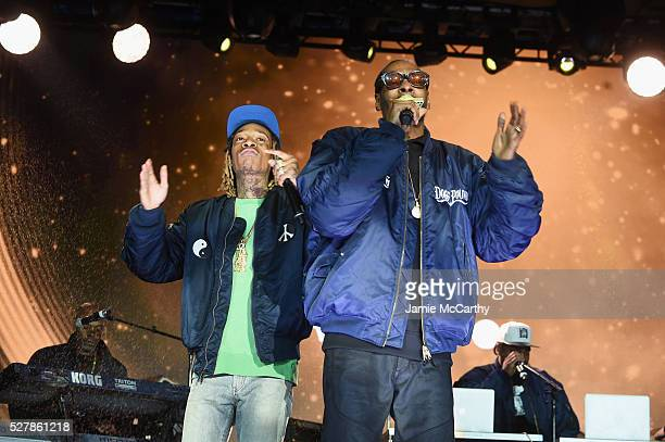 Wiz Khalifa and Snoop Dog perform onstage at the AOL NewFront 2016 at Seaport District NYC on May 3 2016 in New York City