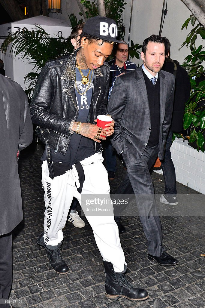 <a gi-track='captionPersonalityLinkClicked' href=/galleries/search?phrase=Wiz+Khalifa&family=editorial&specificpeople=7183449 ng-click='$event.stopPropagation()'>Wiz Khalifa</a> arrives at the Warner Music Group GRAMMY Celebration - Presented by Mini at Chateau Marmont on February 10, 2013 in Los Angeles, California.