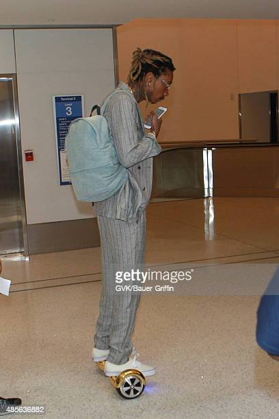Wiz Khalifa is seen at LAX on August 28 2015 in Los Angeles California